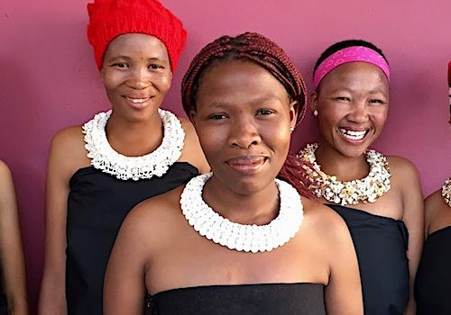 Five Namibian ladies display their stunningly crafted necklaces.