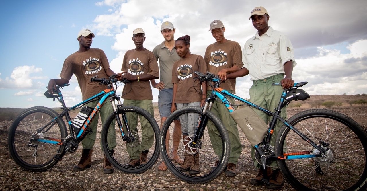 A group of Namibian rhino rangers pose with their SunCycles